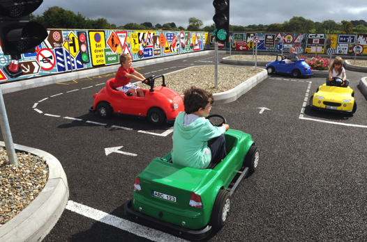kids driving toy cars